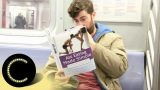 Bloke Takes Confronting Fake Book Covers Onto Train