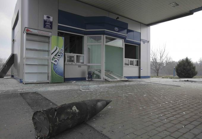 A part of ammunition is seen scattered at a petrol station