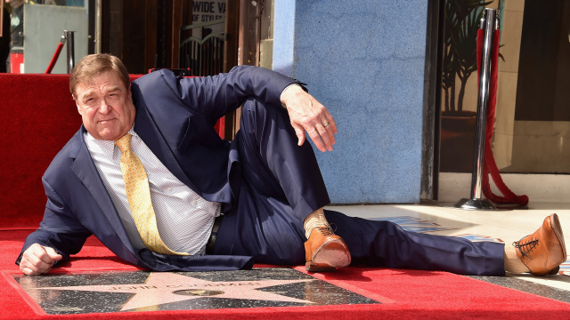 John Goodman looking suave af in front of his Hollywood star.