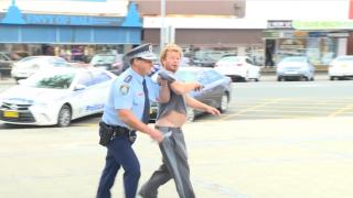 Policeman Stops Press Conference On Live TV To Arrest Beer Drinking Heckler