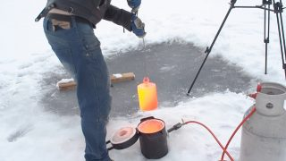 Here's What Happens When You Put 20kg Of Red Hot Steel In A Frozen Lake