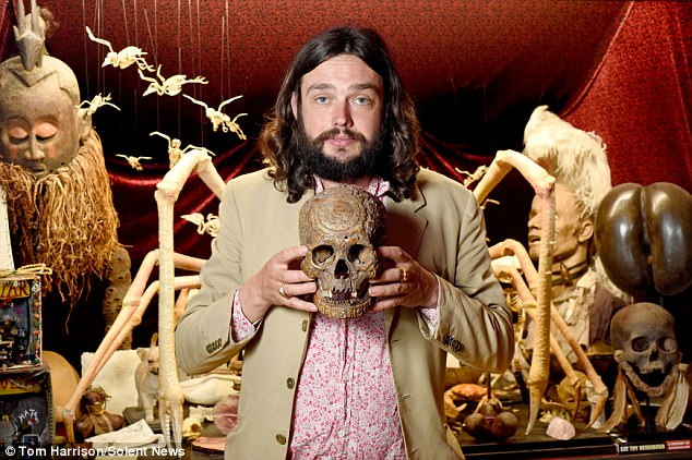 Mr Wynd holding a 18th Century Tibetan skull carved with a wheel calendar. This guys seems totally normal...