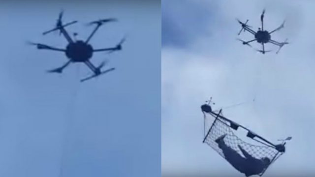 Bloke Uses Drone To Fly Himself Above A Busy Road, While Chilling in a Hammock