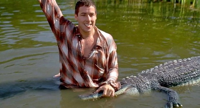 We all know there's only one man you can rely on to get balls out of an alligator's waterhole. Credit: Happy Madison Productions