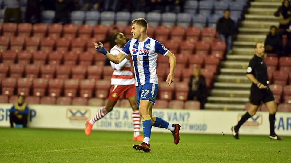 Colclough celebrates his first and Wigan's second goal. Credit: Wigan Athletic