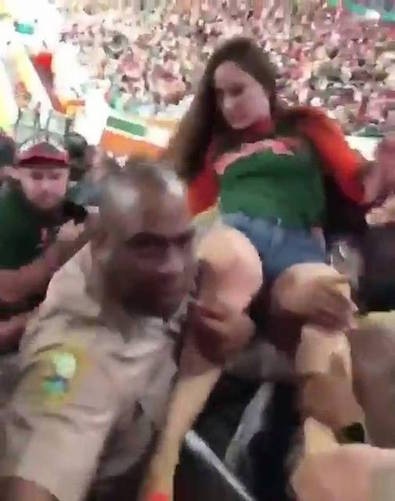 She should've just enjoyed the chance to crowd surf on a couple of cops