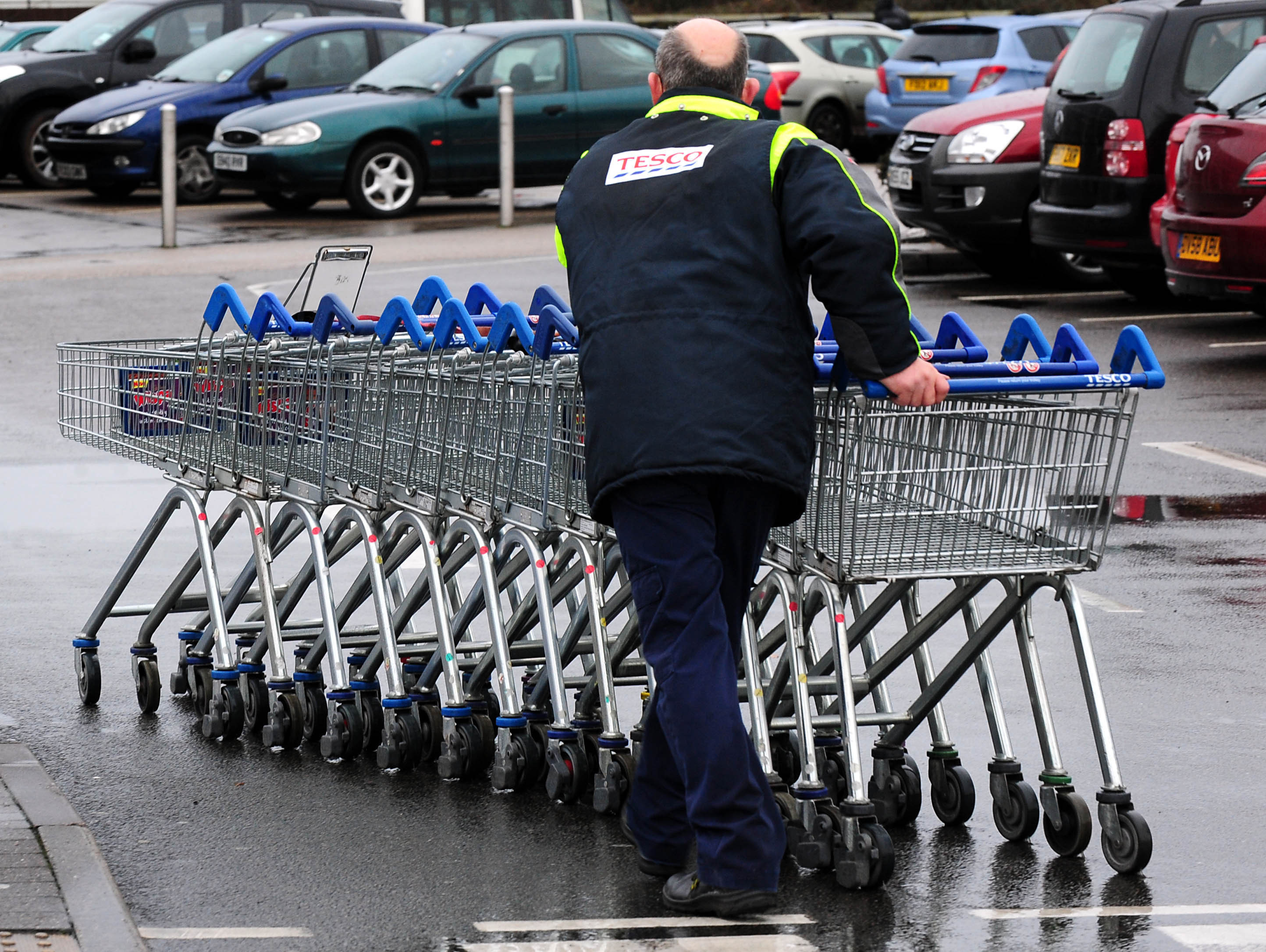 The only job bald old men can get is pushing trolleys? Screw you, Tesco! Credit: PA