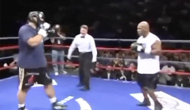 Even at 50 yrs old Mike Tyson has to hold opponent up after delivering right hand cannon