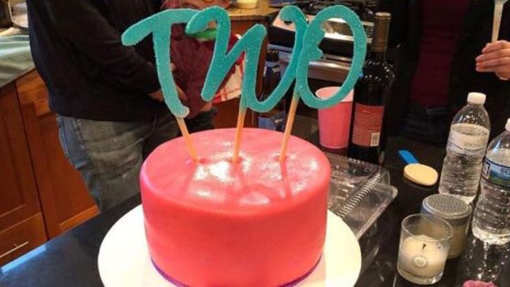 Toddler's birthday cake topper says something totally different from behind