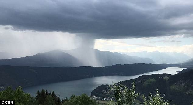 "Spectacular timelapse video captures ""microburst"" storm dumping tonnes of water in lake"