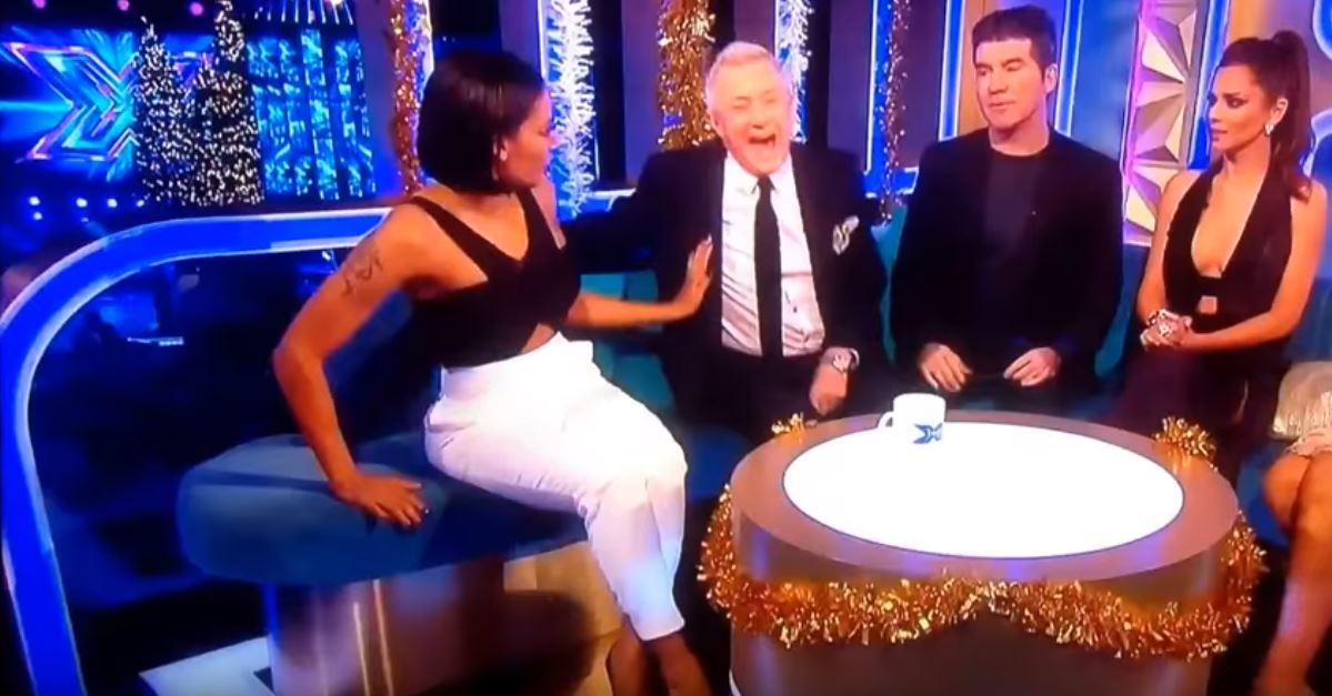 After being called on it, he thinks it's funny despite her discomfort. Credit: The X Factor