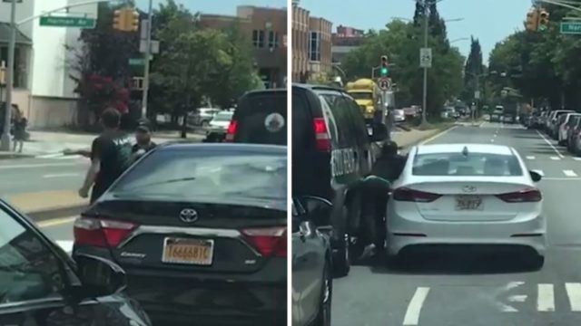 Wild road rage brawl in the middle of the street ends with car-smash finishing move