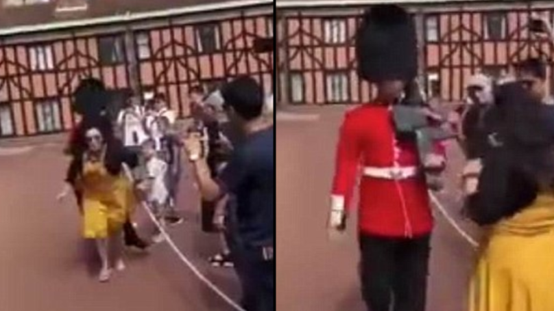 Queen's guard shoves the sh*t out of sheila in his way