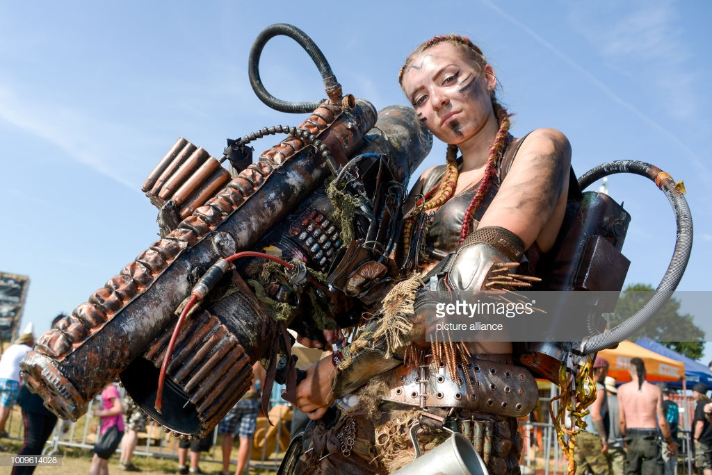 02 August 2018, Germany, Wacken: A festival visitor wears an end-time outfit at the Wacken Open Air. According to the organisers, the world's largest heavy metal festival starts with 75,000 visitors. Photo: Axel Heimken/dpa (Photo by Axel Heimken/picture alliance via Getty Images)