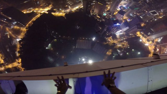 Base jumper makes f*cken epic entrance to rooftop pool party