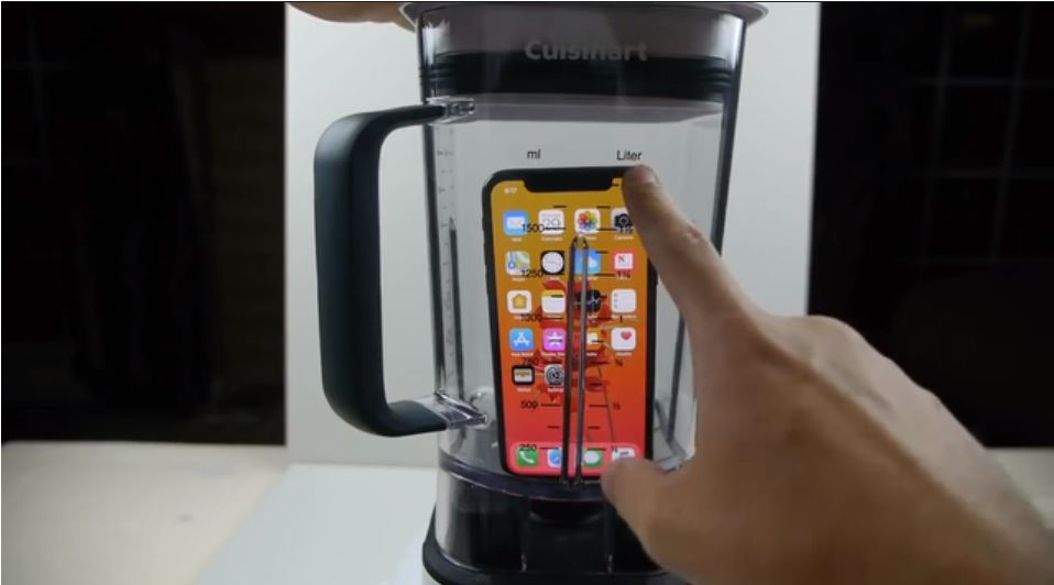 Bloke blends up an iPhone and drinks it