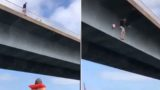 Aussie bloke launches himself off bridge to deliver beers to his mates