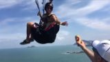 F*cken legend catches a beer while hang gliding