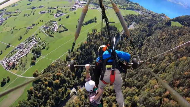 Hang glider cheats death after realising harness was not attached