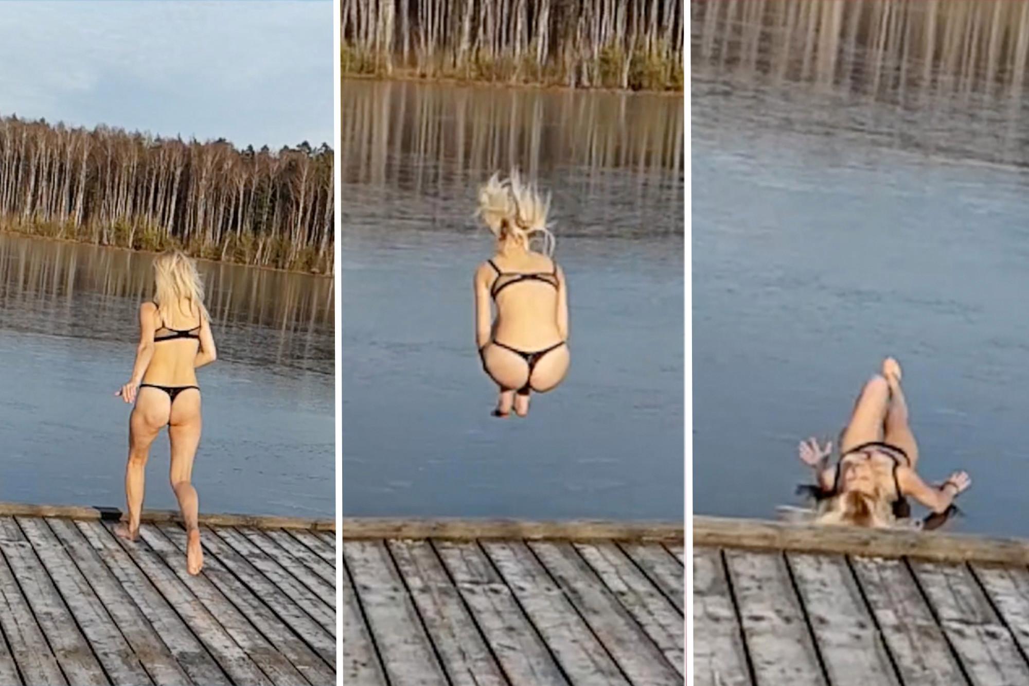 Russian bikini sheila bounces off frozen lake after trying to jump in it