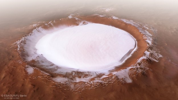 Unreal photos show huge crater full of ice discovered on Mars