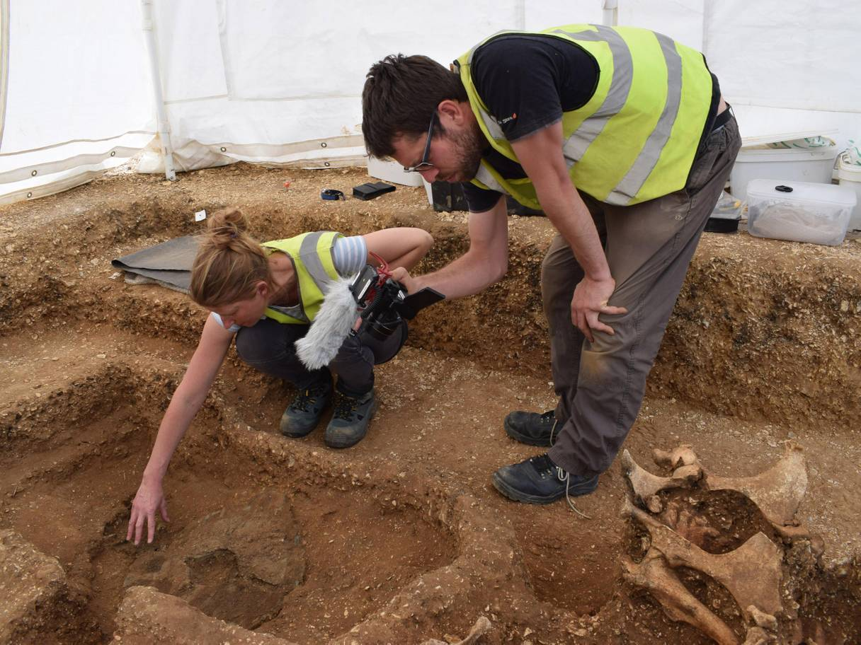 Unearthing the chariot. Credit: David Keys/BBC