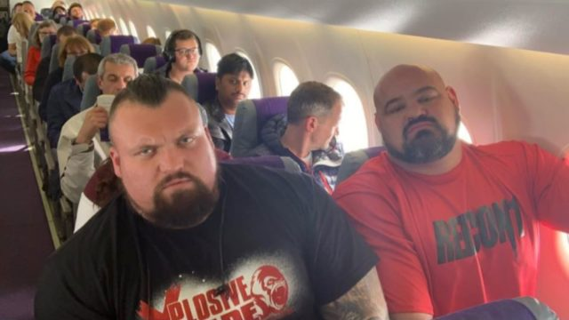 Two of the world's strongest men were sat next to each other in economy class