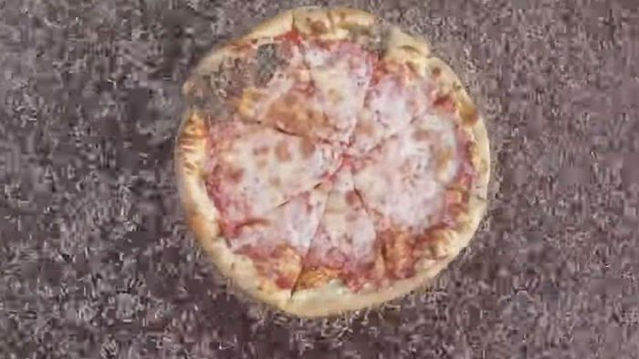 F**ked up science experiment shows 10,000 maggots eating a pizza in 2 hours