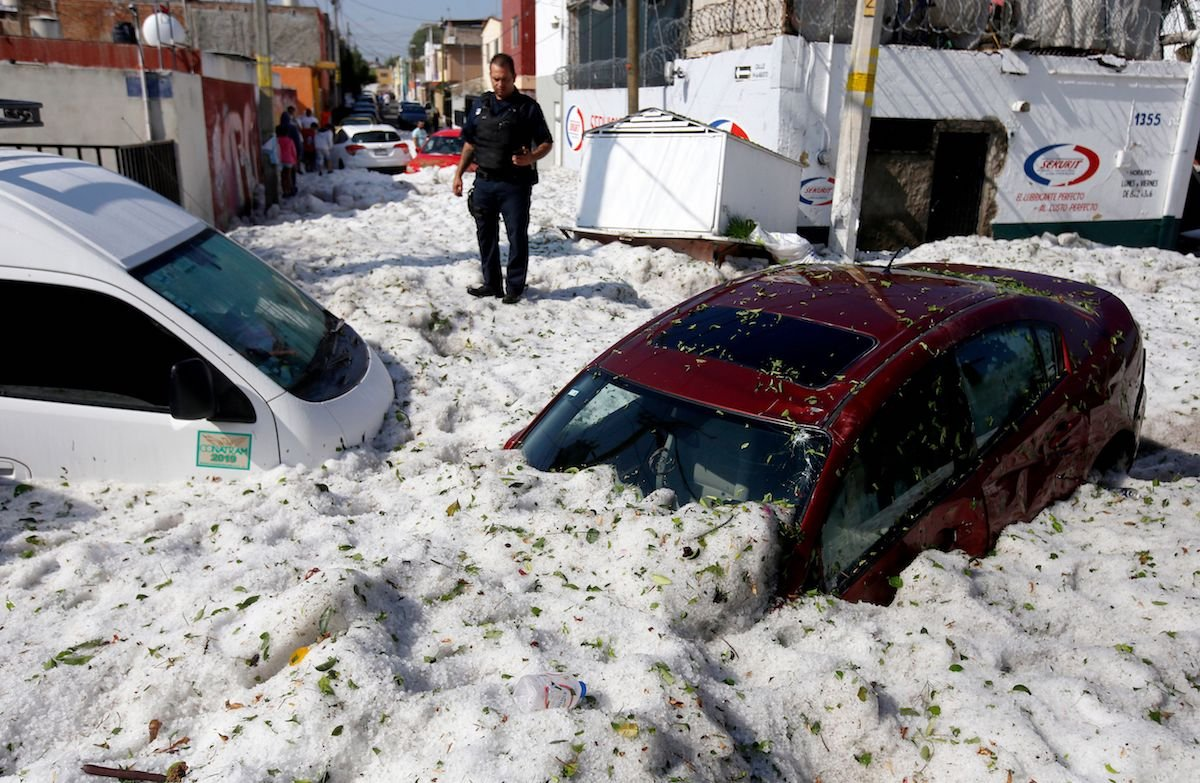 Photos show freak hailstorm during summer with 5ft of ice on Mexican roads