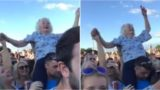 Granny spotted rocking out on bloke's shoulders at music festival