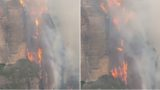 Flames 'like a waterfall' rage 200m up a cliff in Australian bushfires