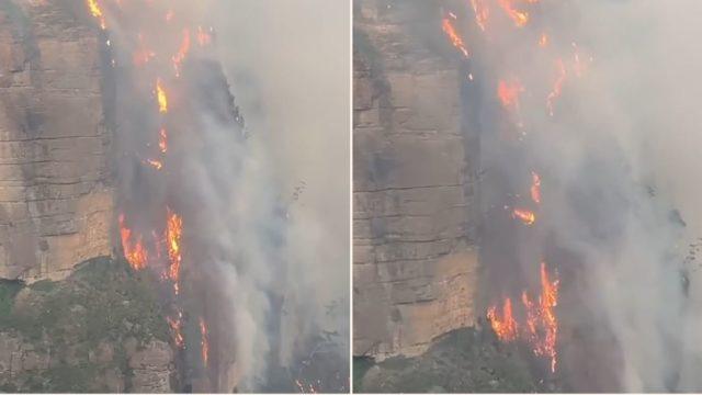 Flames 'like a waterfall' rage 200m up a cliff in Australian bushfires