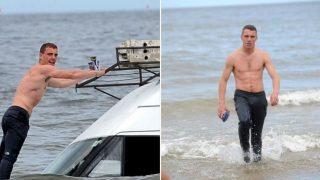 Shirtless bloke swims to sunken van to save his durries