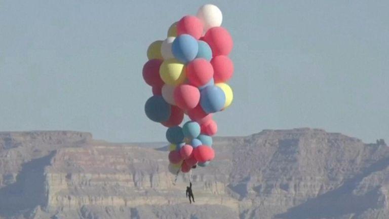 Stuntman David Blaine soars 25,000 feet holding helium balloons