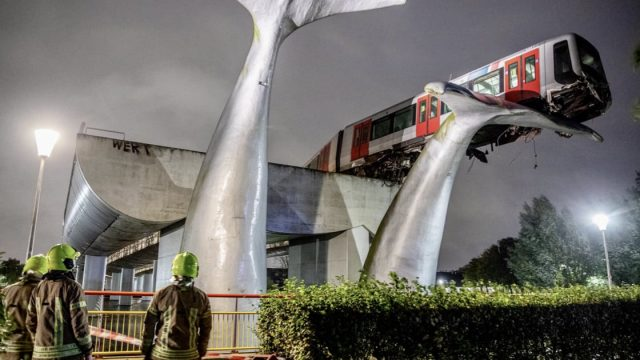 Dutch train crashes through barrier and lands on giant whale sculpture