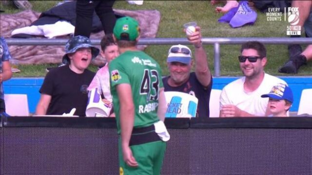 Bloke catches ball in beer cup at the Cricket – does what any good Aussie should
