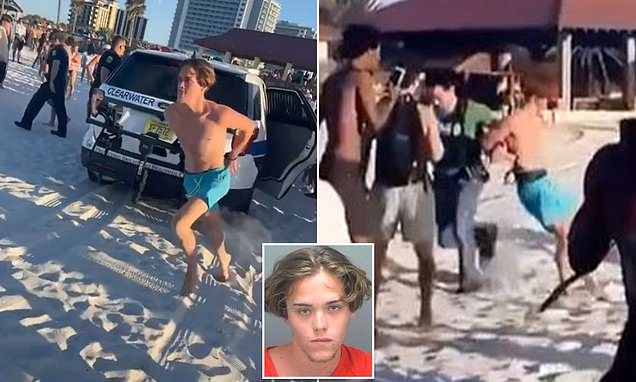 Arrested Spring Breaker cheered on by beachgoers as he flees cops in handcuffs